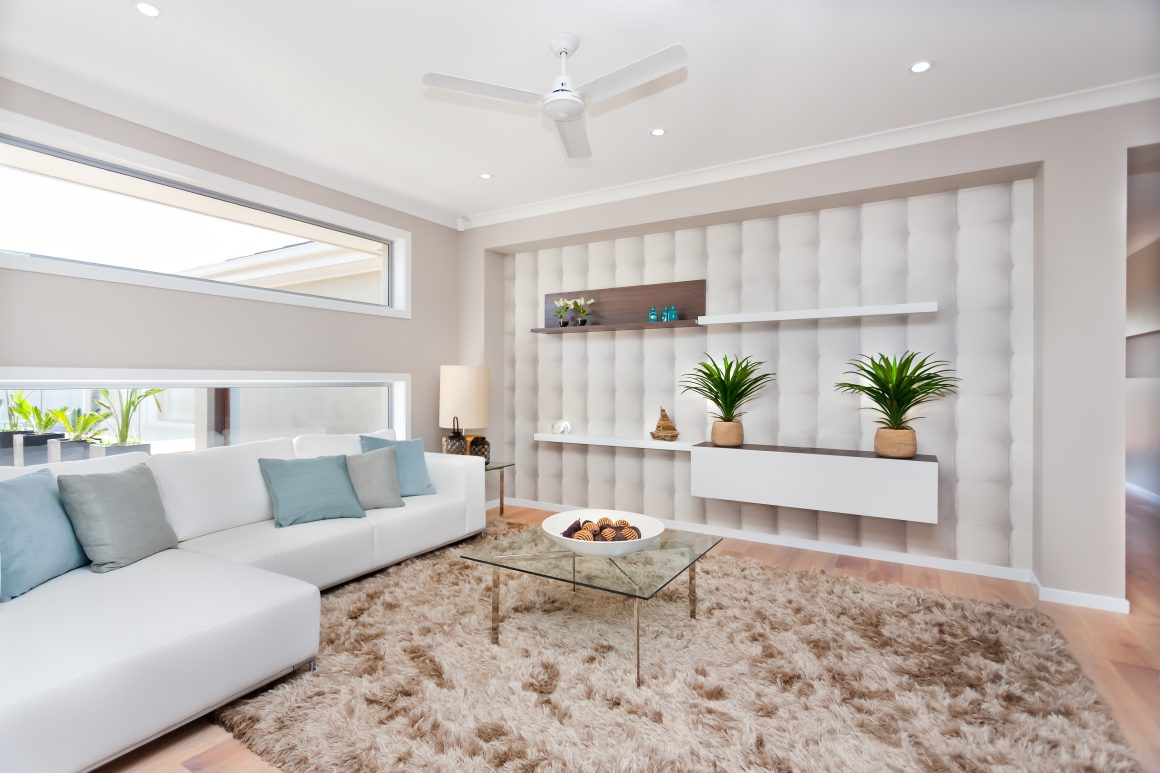Small three-blade white utility fan in cozy living room space