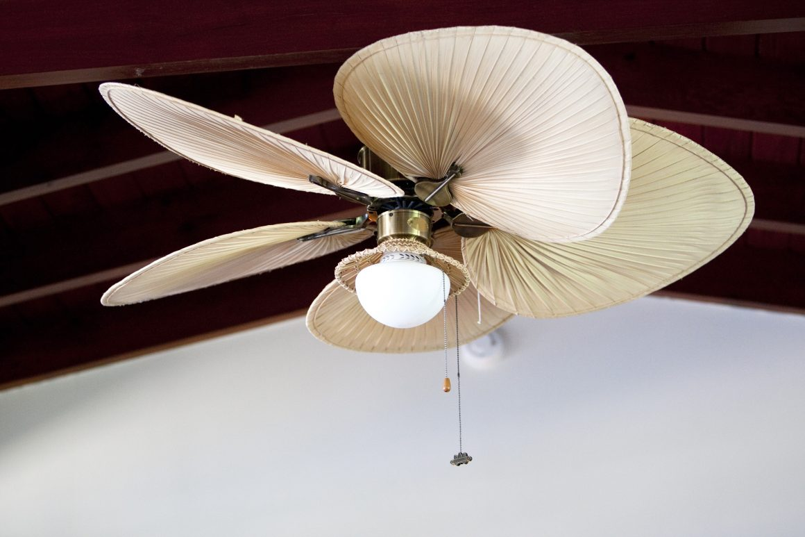 Indoor tropical ceiling fan with palm leaf blades