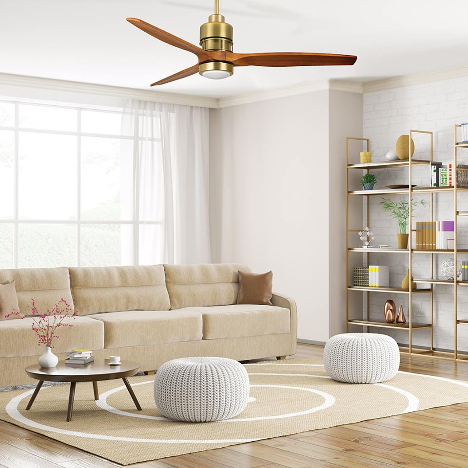 Clean, minimalist living room with white couch, gold shelves, and a 3-blade Hånsen Lighting ceiling fan