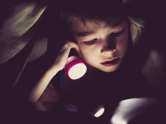 Small child using a sleeping light before bed